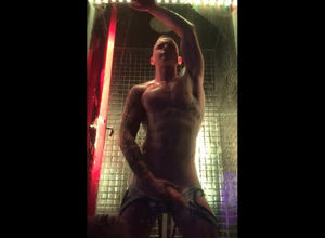 Boy dance Striptease in glass cage