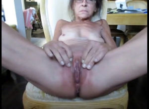 Flabby grandmother displaying her..