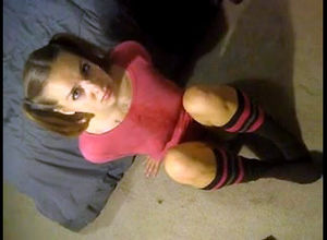 Small teenage dame with pigtails..