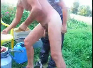 Mature father takes douche bare outdoor