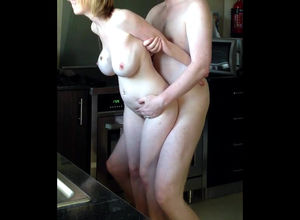 Huge-chested middle-aged gf standing..