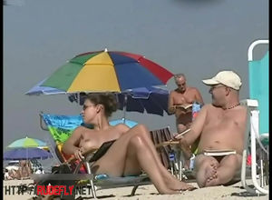 Huge-titted woman sunbathing in a bare..