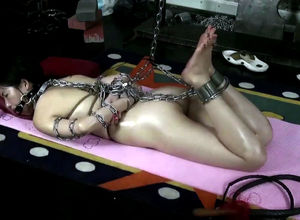 Asian honey Bing Bing corded by chains
